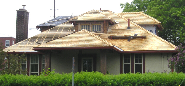 Cedar shingle roof during installation showing the strapping grid.